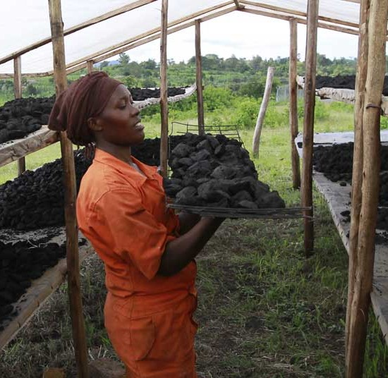 A woman works at the briquette plant in Kyaka II refugee settlement, Uganda