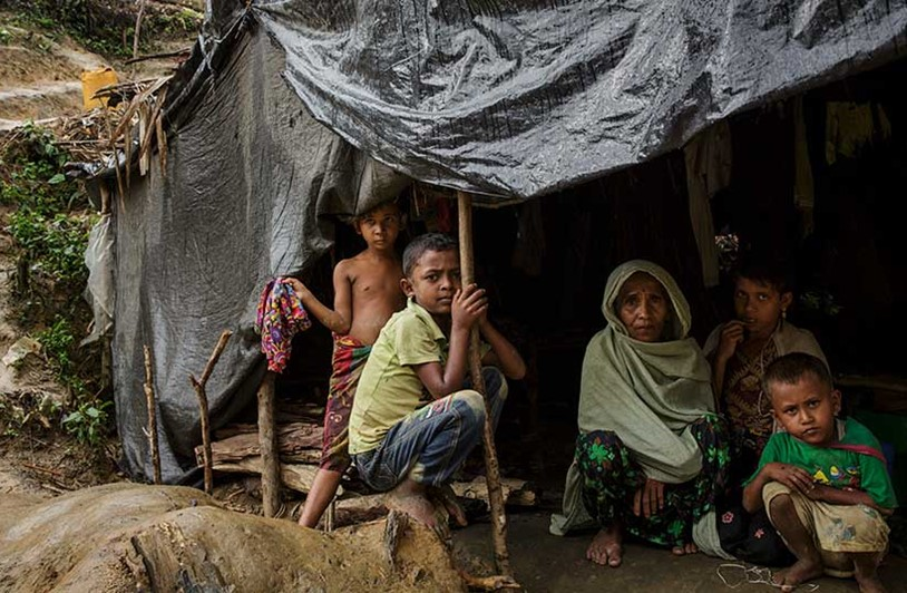 Rohingya family sheltering from the storm